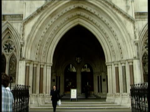 Woman wins case against stage hypnotist ITN London High Court GVs High Court