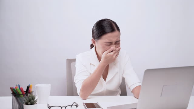 woman wipe her nose at office isolated white background - nose stock videos & royalty-free footage