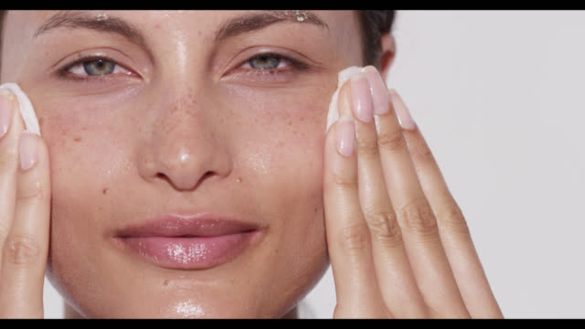 woman wipes of cleanser with cotton pads - anti aging stock videos and b-roll footage