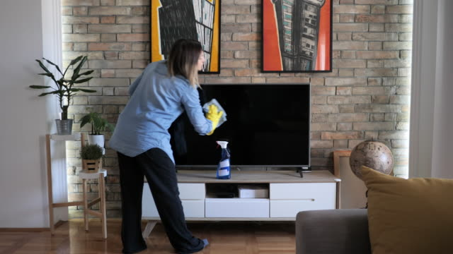 woman wiping dust from furniture - washing up glove stock videos & royalty-free footage