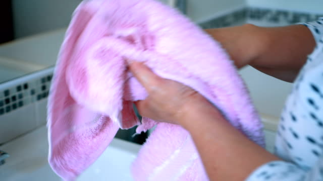 woman wiping hands - towel stock videos and b-roll footage
