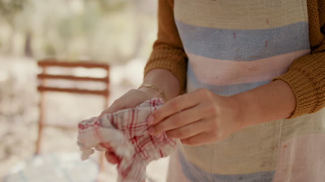 woman wiping hands with tea towel - environmental conservation stock videos & royalty-free footage