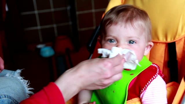 woman wiping the child mouth with napkin - napkin stock videos and b-roll footage