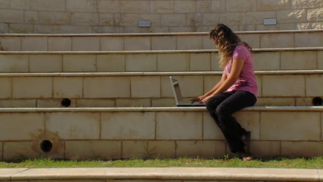 Woman with a laptop. Outdoors