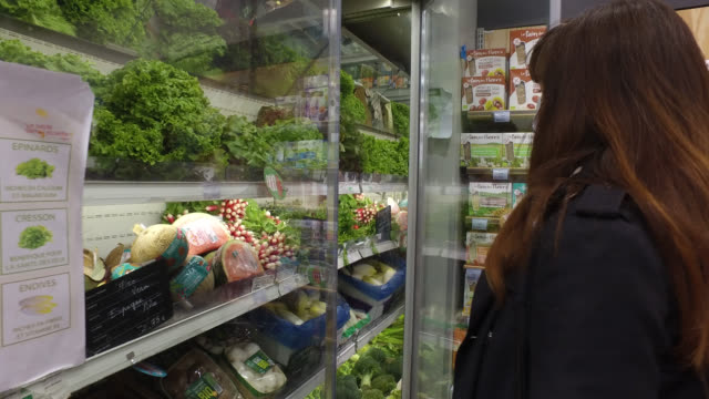 woman, with a protective mask, goes shopping for food, buy a salad in an organic supermarket, on may 13, 2020 in paris, france. france has started a... - 45 49 years stock videos & royalty-free footage