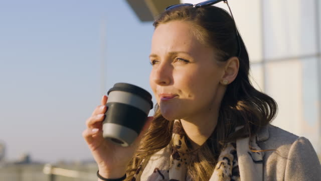 woman with a travel mug with coffee - environment stock videos & royalty-free footage