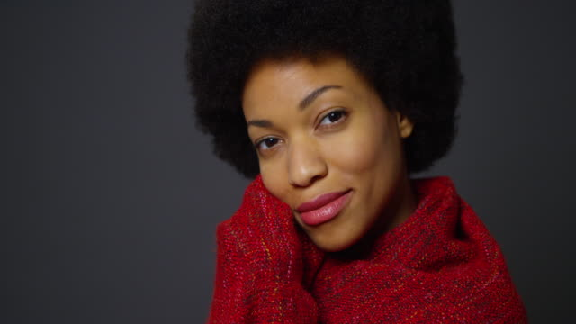 woman with afro wearing red shawl