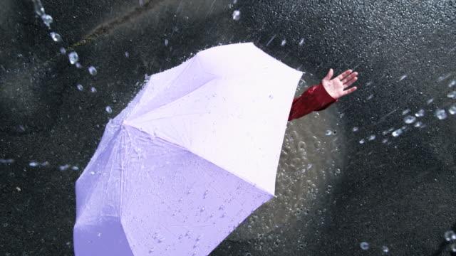 woman with an umbrella standing in the rain - ombrello video stock e b–roll