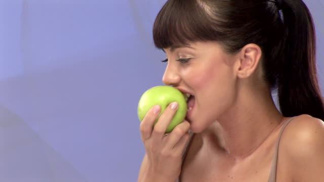woman with apple - bangs stock videos and b-roll footage