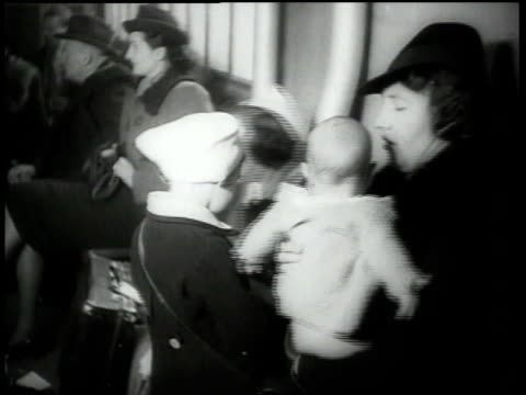 1938 ha woman with baby and children standing in line / paris, france - anno 1938 video stock e b–roll