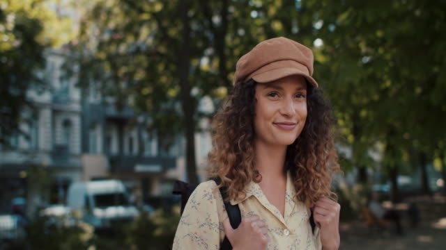 woman with backpack in berlin, smiling - curly stock videos & royalty-free footage
