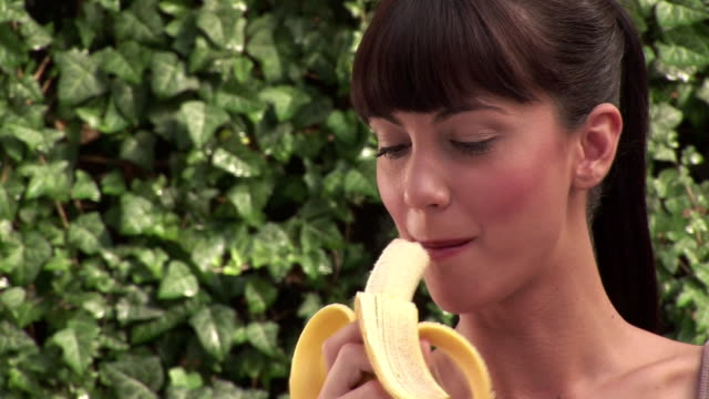 woman with banana - banana stock videos and b-roll footage
