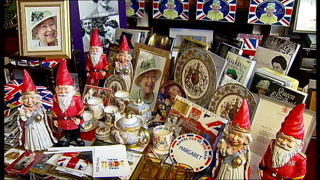 woman with biggest collection of royal memorabilia walls and shelves full of royal memorabilia alongside staircase dresser filled with royal... - souvenir stock videos and b-roll footage
