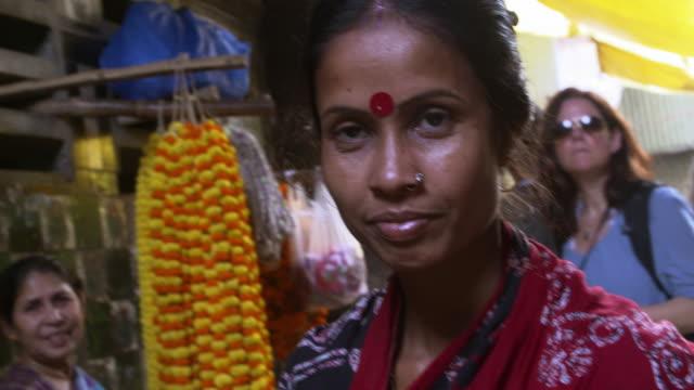 woman with bindi in forehead buying in kolkata flower market - bindi stock videos and b-roll footage