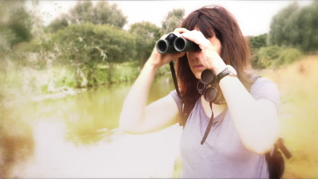 Woman with Binoculars. Riverside. 2.