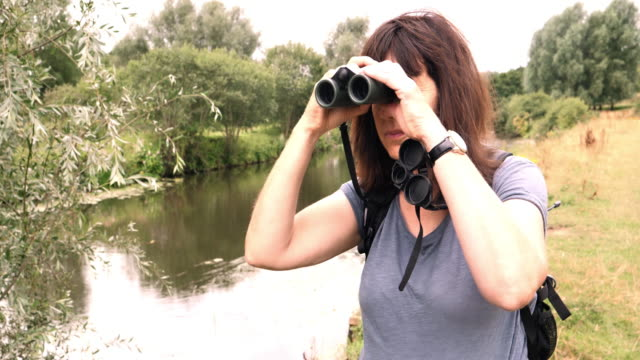 Woman with Binoculars. Riverside.