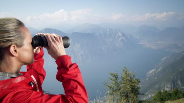 woman with binoculars - coat stock videos & royalty-free footage