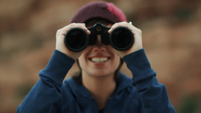 woman with binoculars - binoculars stock videos & royalty-free footage