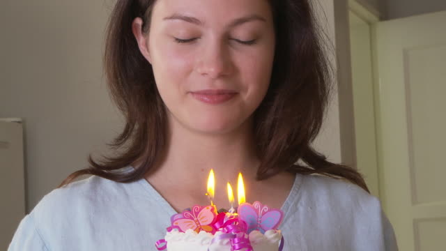 woman with birthday cake - birthday candle stock videos & royalty-free footage