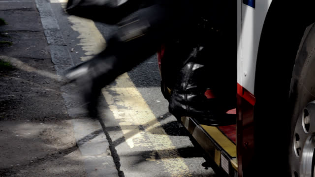 stockvideo's en b-roll-footage met woman with black boots boarding a bus - bushalte
