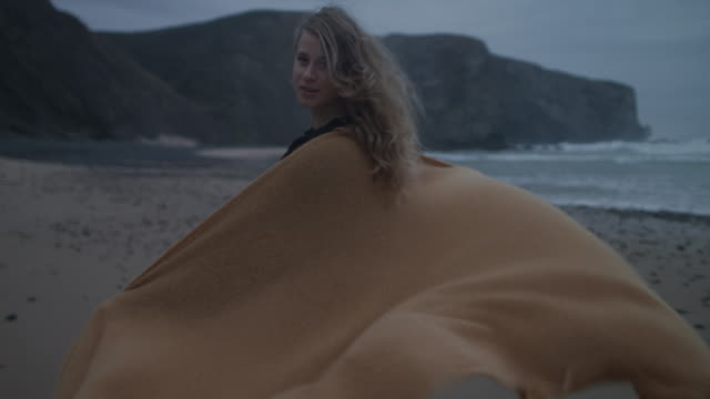 stockvideo's en b-roll-footage met woman with blanket walking on deserted beach - travel destinations