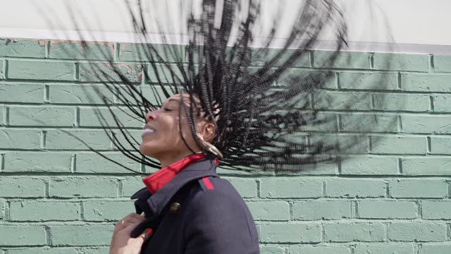 woman with braids flicking hair back - braided hair stock videos & royalty-free footage