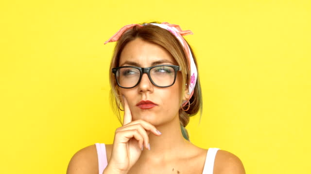 4k woman with bright idea - coloured background stock videos & royalty-free footage