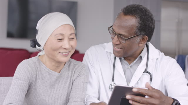 woman with cancer reviews test results with doctor - patient stock videos & royalty-free footage