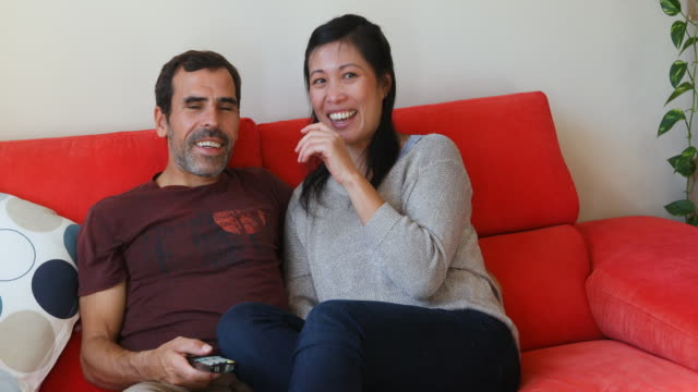 woman with cerebral palsy watching tv with her partner - david bond stock videos & royalty-free footage