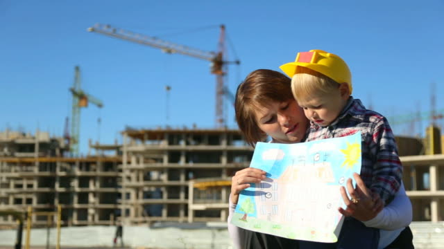 woman with child at the construction site - crane construction machinery stock videos & royalty-free footage