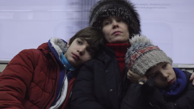 woman with children sitting in the subway - grey jacket stock videos and b-roll footage