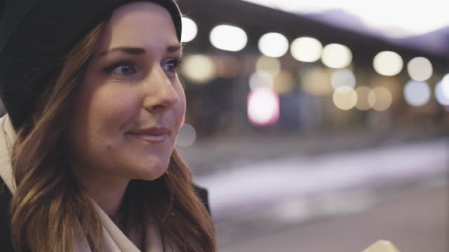 Woman with Christmas Gift on Train Station