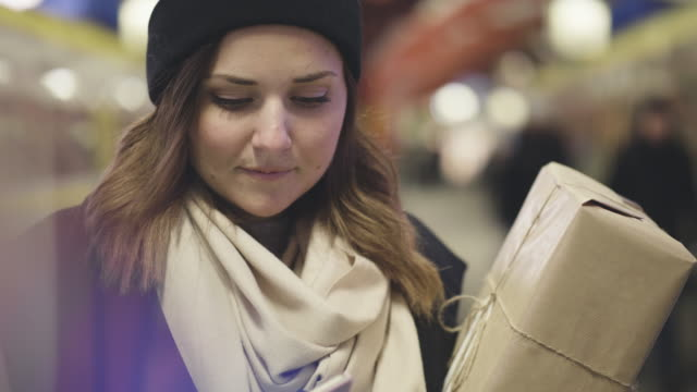 woman with christmas gift on train station - swedish culture stock videos and b-roll footage