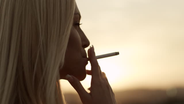 woman with cigarette - cigarette stock videos & royalty-free footage