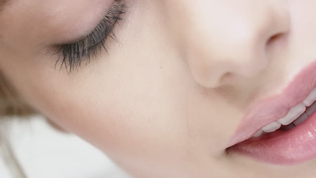 woman with closed eyes touching her skin - beauty treatment stock videos & royalty-free footage