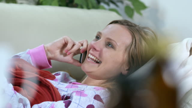 HD DOLLY: Woman With Cold Talking On The Phone