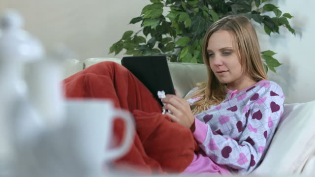 HD: Woman With Cold Using Tablet