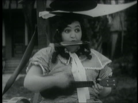 b/w 1920 woman with cymbal on head playing harmonica + ukelele - cymbal stock videos and b-roll footage
