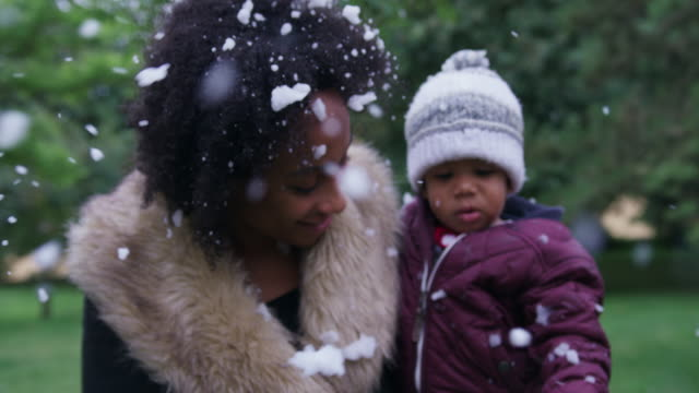 woman with daughter in snowfall - 18 23 months stock videos & royalty-free footage