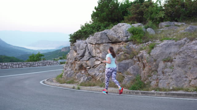 woman with diabetes running in nature - type 1 diabetes stock videos & royalty-free footage