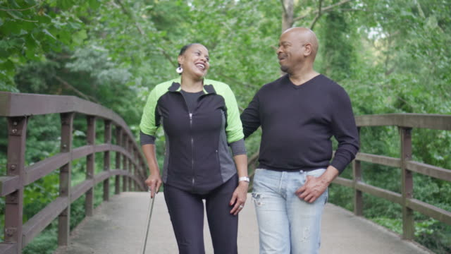 Woman with Differing Abilities and Man Enjoy Nature Together