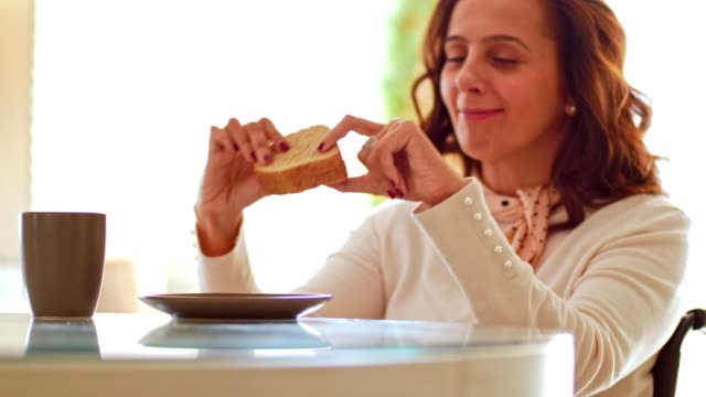 woman with disability eating sandwich - sandwich stock videos & royalty-free footage