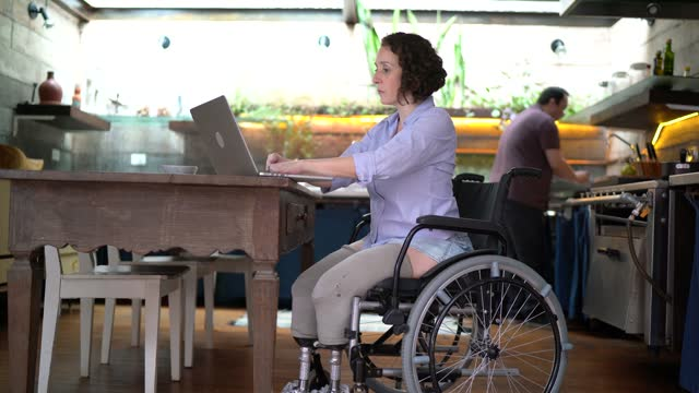 woman with disability working and husband helping her at home - husband stock videos & royalty-free footage