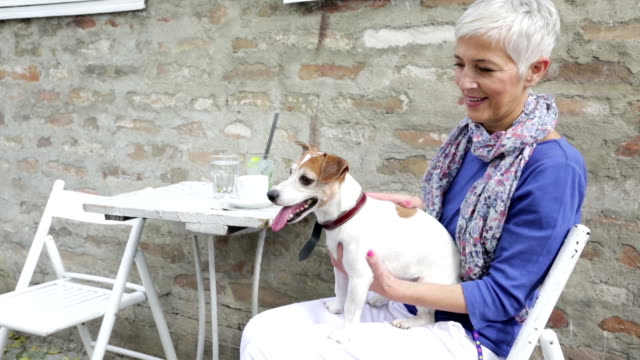 Woman with dog in cafe
