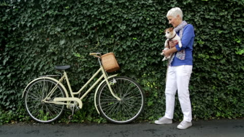 woman with dog on bicycle - white hair stock videos & royalty-free footage