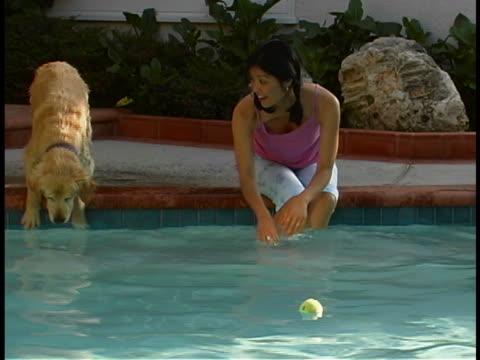woman with dog - utebassäng bildbanksvideor och videomaterial från bakom kulisserna