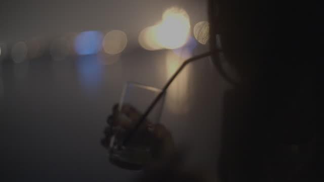 woman with drink at night club - dubai - strohhalm stock-videos und b-roll-filmmaterial