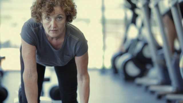 CU TU TD Woman with dumbbells exercising in gym / Vancouver, British Columbia, Canada