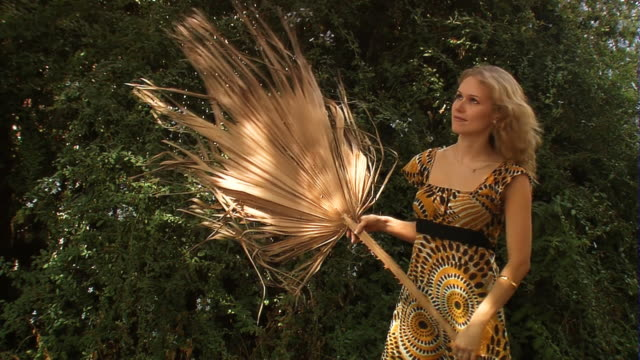 Woman with exotic broom