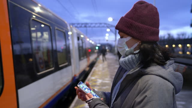 woman with face mask boarding train - passenger train stock videos & royalty-free footage